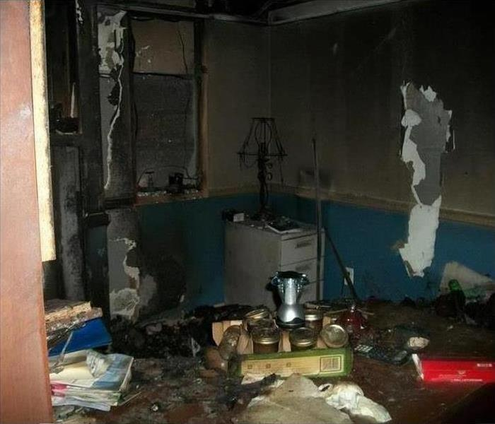 A room covered soot and smoke damage after a fire